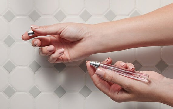 Thymes cologne spray pen being applied to wrists