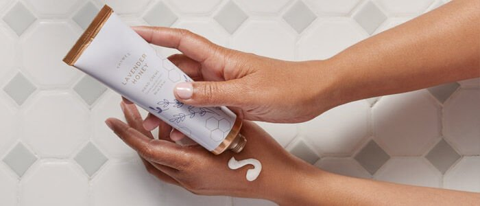 Thymes hand cream being applied to hands